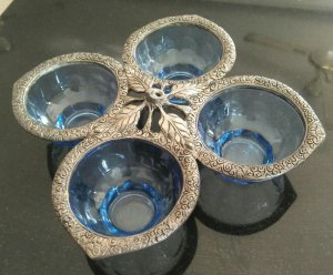 Glass bowl set with coating of brass